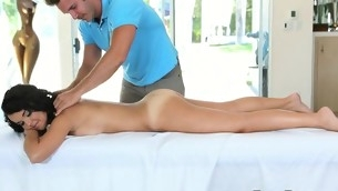 Stud is giving hot darling a lusty oil rubbing on her cum-hole